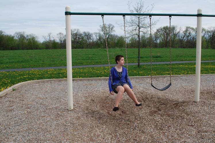 07-24-17 lonely girl on swingset